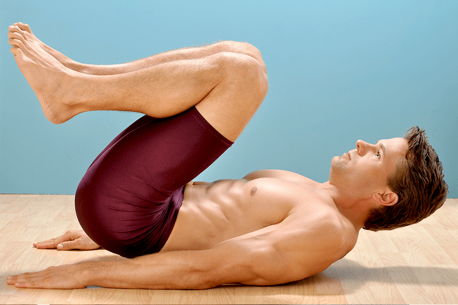 Man doing reverse crunches
