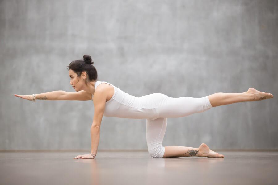 Woman doing quadruped arm opposite leg raises