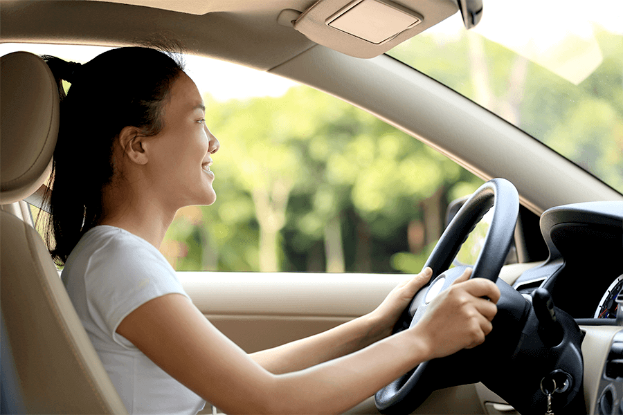 Woman with good driving posture