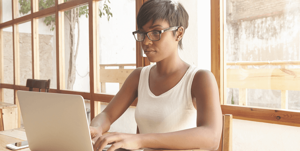 Woman with good posture working on her laptop