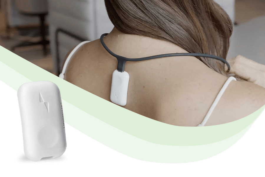 Upright Go2 and Upright Necklace on a woman's back