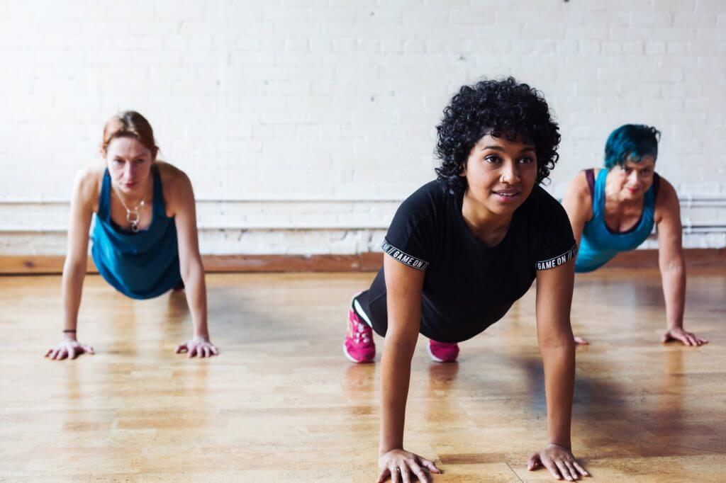 Three people exercising their core muscles to improve back posture