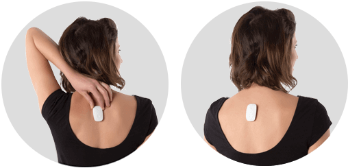 A woman placing her Upright device on her upper back